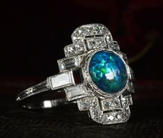 This ring makes me glad Art Deco-influenced jewelry design is making a comeback. 1920s Art Deco Diamond & Black Opal Cocktail Ring, Platinum, $4250 via Erie Basin