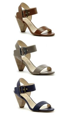 Leather mid heel sandals with triangle-shaped heels and metal hardware