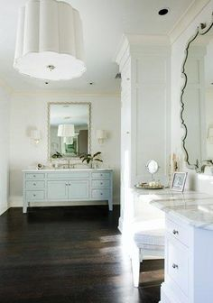 white bath with pale blue vanity