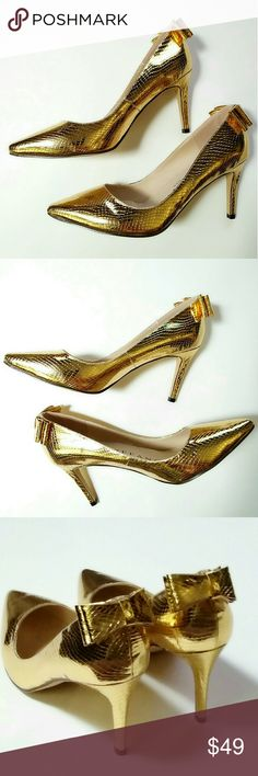 MARC DEFANG NEW YORK Gold Pumps Bow Detail Brand new with tags (NWT) MARC DEFANG NEW YORK Gold Textured Pumps/Heels/Sandals. Patent man-made leather. Pointed toe design. Stunning bow detail on the back. Size 8.5. Approximate heel height is 3.5 inches. I noticed a two tiny scuffs on the right shoe. Marc Defang New York is the gold standard in designer shoes! Marc Defang Shoes