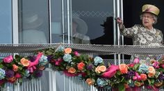 Queen Elizabeth watches a horse race on the second day of the Epsom Derby festival in Surrey on 6 June 2015