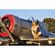 1940s style aviator pin-up girl posing with a vintage T-6 Texan aircraft Canvas Art - Christian KiefferStocktrek Images (35 x 23)
