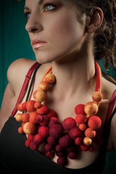 Handmade felted necklace made of yellow orange red and purple by Dahrana