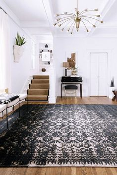 Entrance foyer with beautiful area rug.