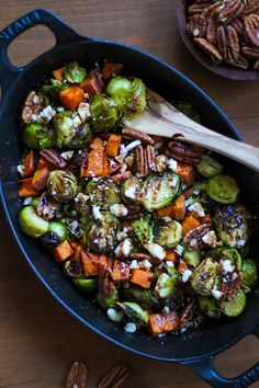 Roasted Brussels Sprouts and Sweet Potatoes with Pecans, Feta, and Balsamic Reduction   TheRoastedRoot.net #healthy #vegetarian