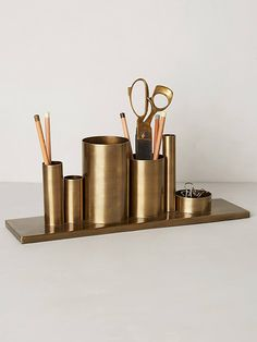 10 Bold Office Essentials to Bring Out Your Inner Boss | GO FOR GOLD | Give your writing tools the royal treatment with Anthropologie's metallic organizer. Your desktop will look super polished even if your inbox is a hot mess.  Buy It! Codify Pencil holder, $48; anthropologie.com