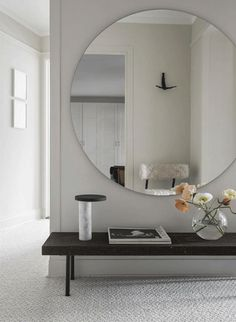 interior cravings - round mirror inspiration and roundup of sources - design by hannah wessman - roundmirror over bench in entryway