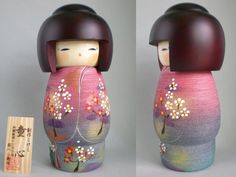 """Design: wears fantastic and elegant purple and pink kimono with red and white plum blossom motif. """"Doshin"""" - Children's Heart. Kokeshi (こけし kokeshi. About Kokeshi Kokeshi have a simple trunk and an enlarged head with a few thin, painted lines to define the face. ). 