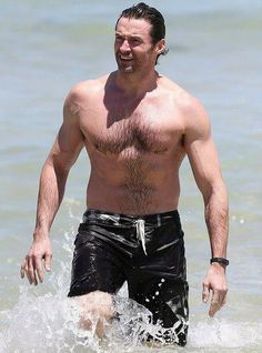 Hugh taking a swim in Bondi Beach waters after arriving in Australia for Christmas 2013