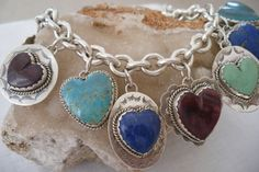 This amazing bracelet has a contemporary design featuring large stunning greenish-blue turquoise stones with golden matrix cut in different size pieces channel set in sterling silver with a rope border. Heart Bracelet, Heart Jewelry, Charm Bracelets, Beaded Jewelry, Coral Turquoise, Turquoise Stone, Turquoise Jewelry, Turquoise Bracelet, American Indian Jewelry