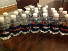Boy birthday party #football #broncos duct tape on water bottles. Easy and fun.