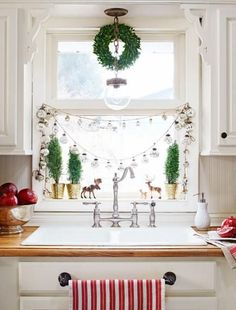 How to dress up your kitchen window for Christmas: http://www.midwestliving.com/holidays/christmas/6-ways-to-craft-a-merry-little-christmas/?page=1