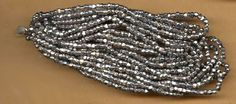 vintage seed beads hex cut silver color beads on original hank, 20 per inch about 1000 beads, they look like metal but they are glass by beadtopiavintage on Etsy