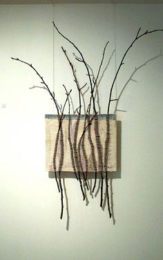 I love this! It's by Joan Baxter - saw it as she was being interviewed by Tash Goswami on http://www.bletheringcrafts.co.uk/ it's called winter skyline - #textile #art #twigs