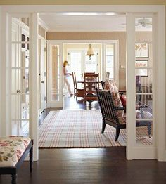 """Widen standard door openings with fixed sidelights to extend sight lines and light from room to room. """"They give you the poetry of French doors without their cost -- or the expense of the hardware you'd need to make them operable,"""" Wilson says."""