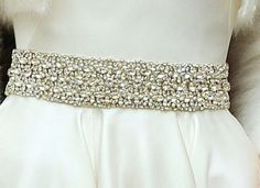 Kate wore this diamante belt with her Alexander McQueen floor-length ivory satin dress with a circle skirt along with a white angora shrug or bolero for her evening reception on the day of her wedding, April 29, 2011.