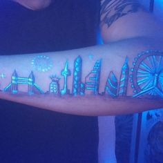 city tattoo black ink uv lights