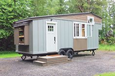 "A pretty little tiny house on wheels, built as part of ""the Handcrafted Movement"" and designed by Matthew Impola."