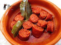 Chorizo al vino (Chorizo cooked in wine) - A typical Spanish Tapa.