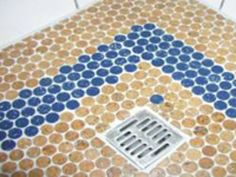 Recycled Wine Corks Make Stylish Penny Tile Flooring.