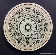 My ornamental circular painting will add style and flair to your home as a decorative art piece! This vintage design is hand drawn and hand painted on wood. It has a crackle finish for an old fashioned look and is protected with polyurethane.