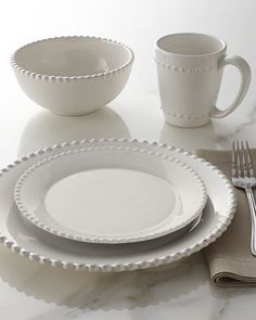 "16-Piece ""Bianca"" Beaded-Edge Dinnerware at Neiman Marcus.  Simple, white dinnerware.  Looks solid."