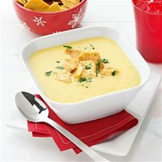 Garlicky Cheddar Cheese Bisque Recipe -I came up with a cheddar cheese soup a while ago and decided to give it a boost with a variety of root vegetables. Crushed pita chips and fresh parsley make fun garnishes. —Patricia Harmon, Baden, Pennsylvania