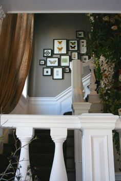 Gray staircase with half white wall