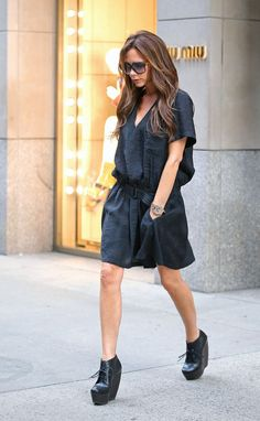 Victoria Beckham - was spotted exiting a boutique in NYC wearing this black Balenciaga belted dress ($1,795) and lace-up wedge booties.