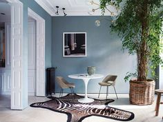 Sophisticated modern apartment in Madrid (80 sqm) #design #decor #home #idea #inspiration #room #style #cozy #spain #blue #paint #wall #tree #round #table