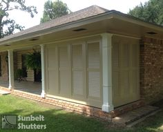 Shutters are not limited to windows.  These Pine Louvered shutters are used in a privacy wall on the corner of a patio.