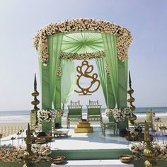 Looking for A floral mandap decor with green curtains? Browse of latest bridal photos, lehenga & jewelry designs, decor ideas, etc. on WedMeGood Gallery. Desi Wedding Decor, Luxury Wedding Decor, Marriage Decoration, Wedding Stage Decorations, Wedding Mandap, Backdrop Decorations, Telugu Wedding, Tent Wedding, Green Wedding