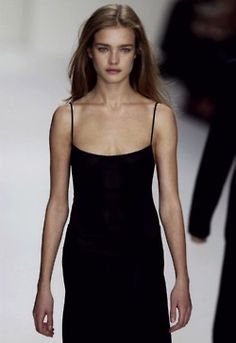 Calvin Klein reminds me that the only accessories a black slip dress needs are bronzer and luminizer.