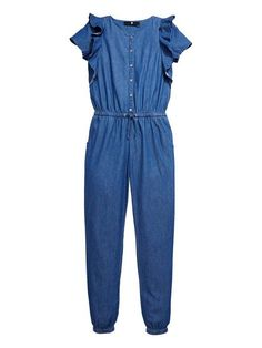 V by VeryGirls Chambray Ruffle Detail Jumpsuit Bringing seventies appeal to her wardrobe is this girls day-to-evening chambray jumpsuit from V by Very. Perfect for casualwear or to be dressed up for parties, this all-in-one really taps into the disco decade's love for denim styles. Featuring super-chic ruffles to the sleeves, the relaxed fit is sporty in silhouette with cuffed ankles and an elasticated waist. Styling Ideas She can team this throwback jumpsuit with tassel trim booties dur...