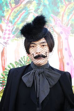 #Fascintor veiled hat with a fake moustache sewn into the veil. I am obsessed with this. #LondonStreetStyle