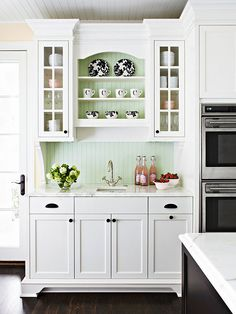 a minty green beadboard backsplash adds a touch of color to a white cottage kitchen. Pick the best color for YOUR kitchen. White Kitchen Cabinets, Kitchen Redo, Kitchen Pantry, Kitchen Dining, Upper Cabinets, Kitchen Ideas, Glass Cabinets, Smart Kitchen, Kitchen White