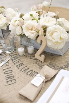 Floral, candles, burlap, and signs make the perfect table setting decor for weddings