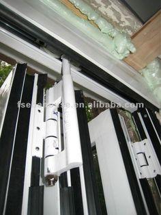aluminum door designs aluminium grille doors and windows folding door Aluminium Doors, Industrial, Window Styles, Folding Doors, Office Ideas, Garage, Windows, Stock Photos, Steel