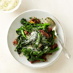 Broccoli rabe and sausage are classic partners in a sandwich. Here, they're delicious together as a side dish.