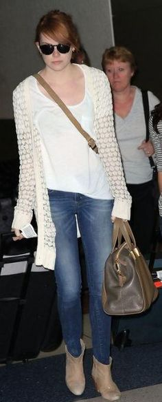 Who made Emma Stone's cardigan, boots and handbag that she wore in New York on August 10, 2011? Sweater – Rag & Bone  Shoes – Rebecca Minkoff  Purse – Fendi
