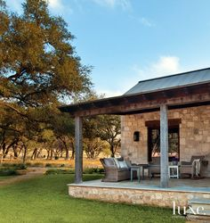 texas hill country architecture stone cedar barn door hill