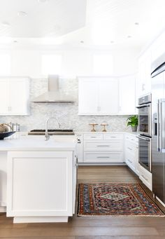 San Clemente Reveal | Part Two - Blackband Design Bright white kitchen design. Vintage turkish rug. Clean lines and fresh white paint in Dunn Edwards DEW383 Cool December.