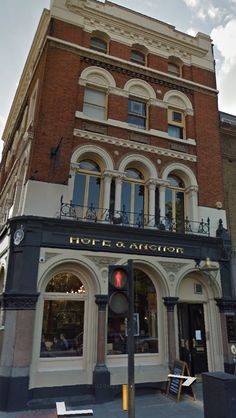 """Hope and Anchor pub, North London. An iconic pub in the late 1970's with bands playing included The Cure, The Stranglers, The Only Ones, The Police, The Stray Cats, The Pogues, Dire Straits, U2, Joy Division, Oliver Coates, The Men They Couldn't Hang amongst others. The band Madness filmed the music video for their cover version of """"One Step Beyond"""" in the Hope and Anchor."""