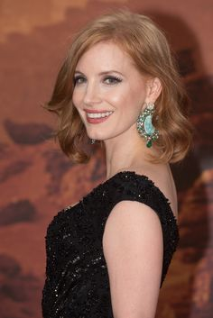 "Jessica Chastain wearing huge earrings at ""The Martian"" premiere."