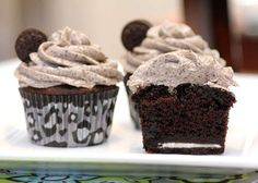 Death by Oreo Cupcakes! surprise Oreo on the bottom, chocolate cupcake, and Oreo-cream cheese frosting <3