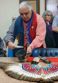 Robert Soto, Linan Apache of Texas, blesses his recently returned eagle feathers. (Photo: Courtesy the Becket Fund for Religious Liberty)