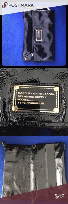 Black Marc Jacobs clutch in good condition Beautiful glossy Marc Jacobs clutch -good condition -no damage or stains  -gold detailing  -several pockets including zippered and magnetic  -Clutch folds over and holds items securely -patent black and easy to clean -wrist band for easy carrying Marc By Marc Jacobs Bags Clutches & Wristlets
