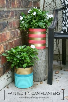 Repurpose large tin cans into metallic stripe planters for your porch!