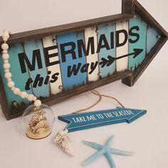 Mermaids LED hanging sign.