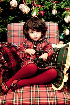 Swoon, I love the mixture of all of this tartan; from the little girl's outfit to the chair.  All by french designer Catherine Painvin.